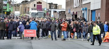 Picture of fans and staff outside the Burnley FC football ground